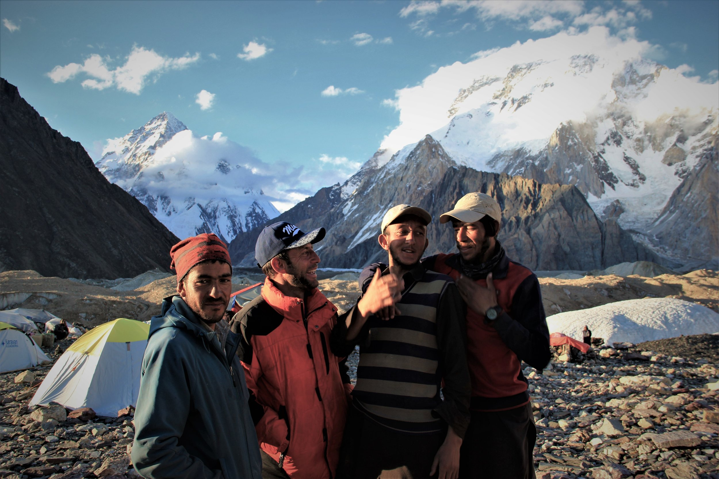 Guide Ejaz , center in the blue cap jokes with porters at Concordia.