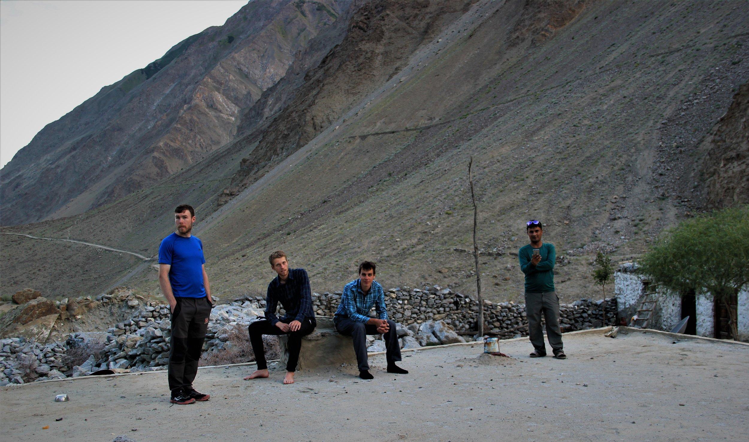 The team before heading to Bondit peak relax on Ibrahim's rooftop , L-R Dairmuid, Elliot, Kadin and Ibrahim.