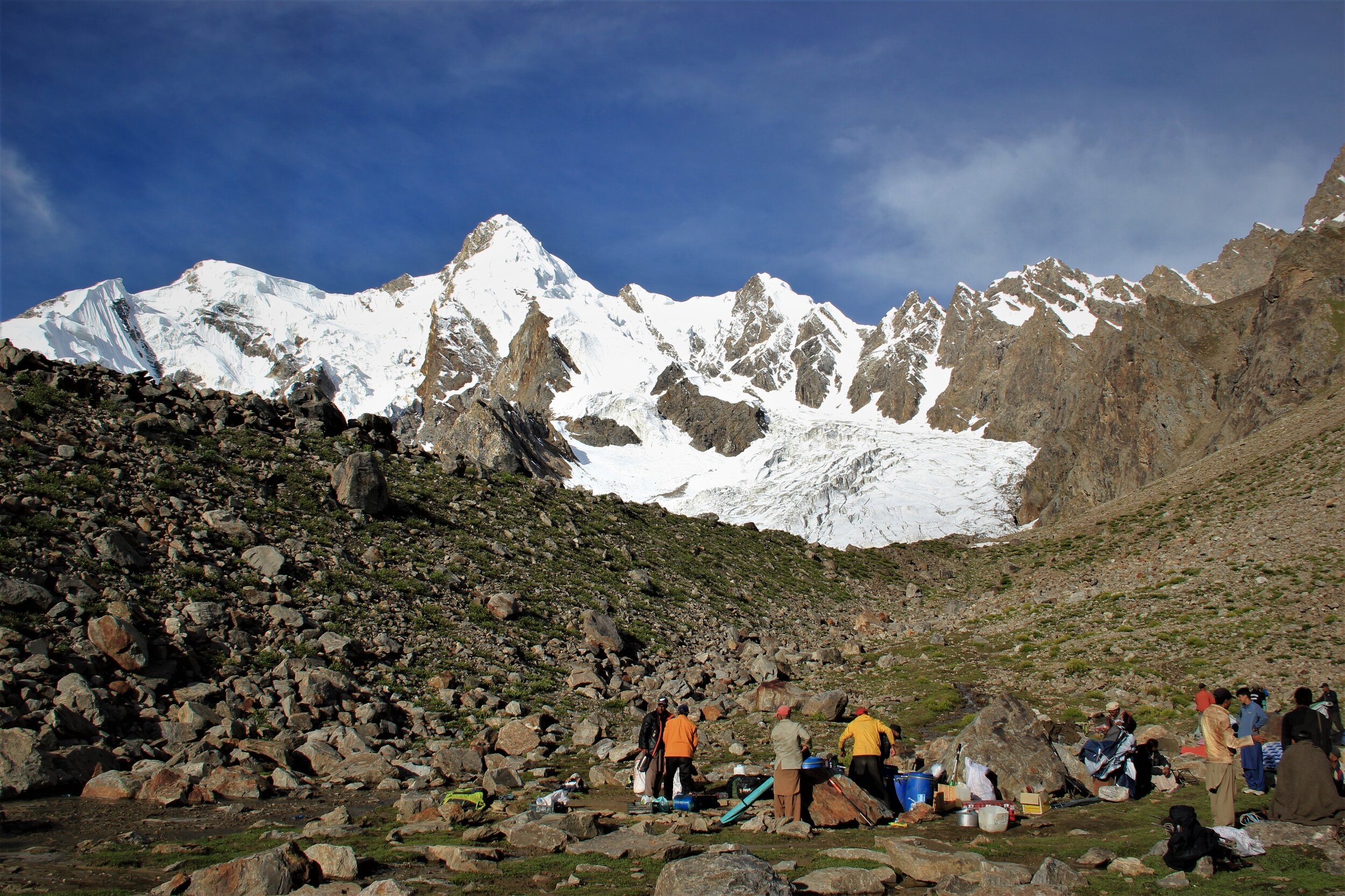 Packing up camp - Bondit stands serenely above - the unknown peak off to the right.