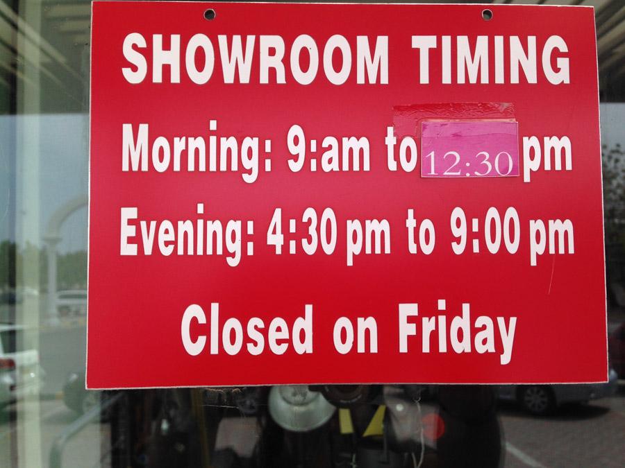 Shop timings at the local print shop.