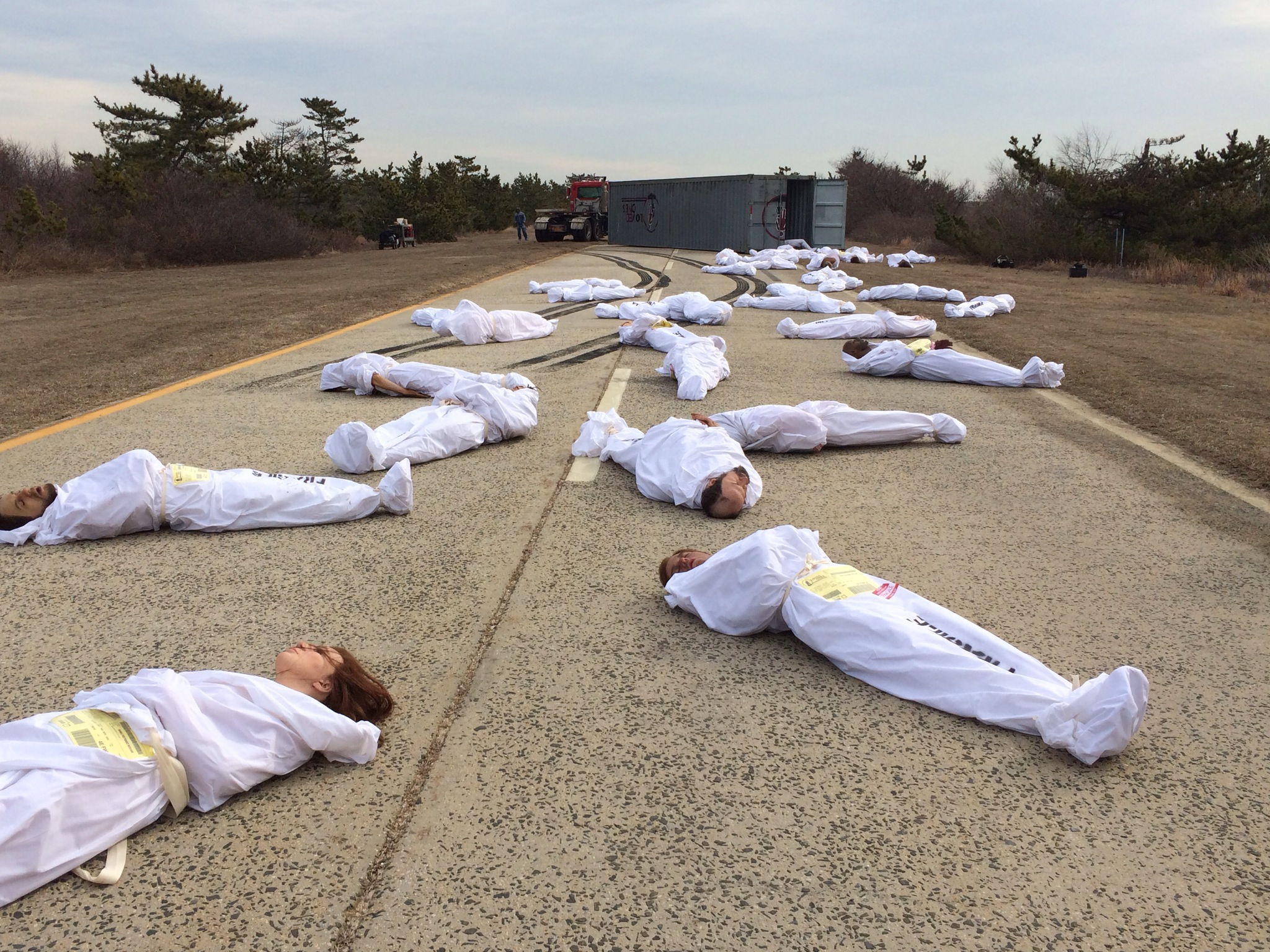 18 bodies in road 2.JPG