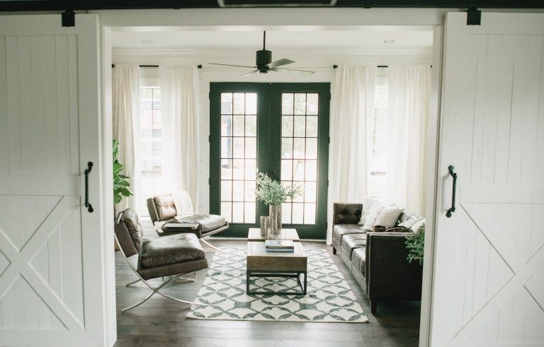 Sliding barn doors are another feature used quite frequently to complete that farmhouse look. This specific space was actually a horse barn converted into a family home.