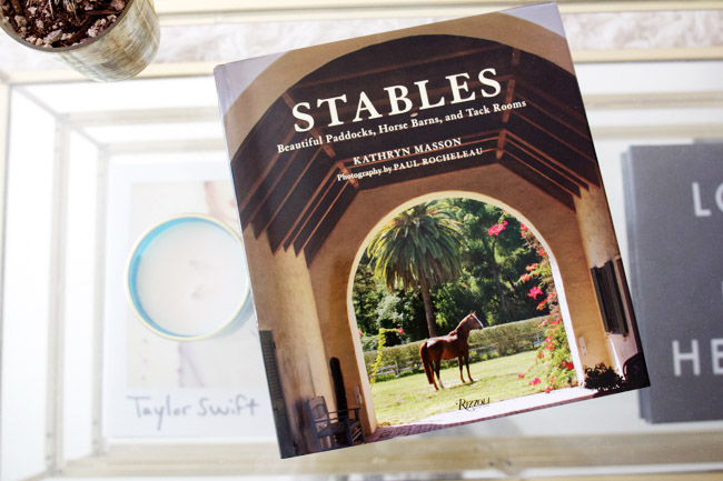 A coffee table book is the perfect way to tie your love for horses and horse farms into a stunning interior design scheme. Stables: Beautiful Paddocks, Horse Barns, and Tack Rooms not only brings the horses into the home, but anyone can flip through for design inspiration past just simply the home. I never get bored of looking at stunning horse farms.