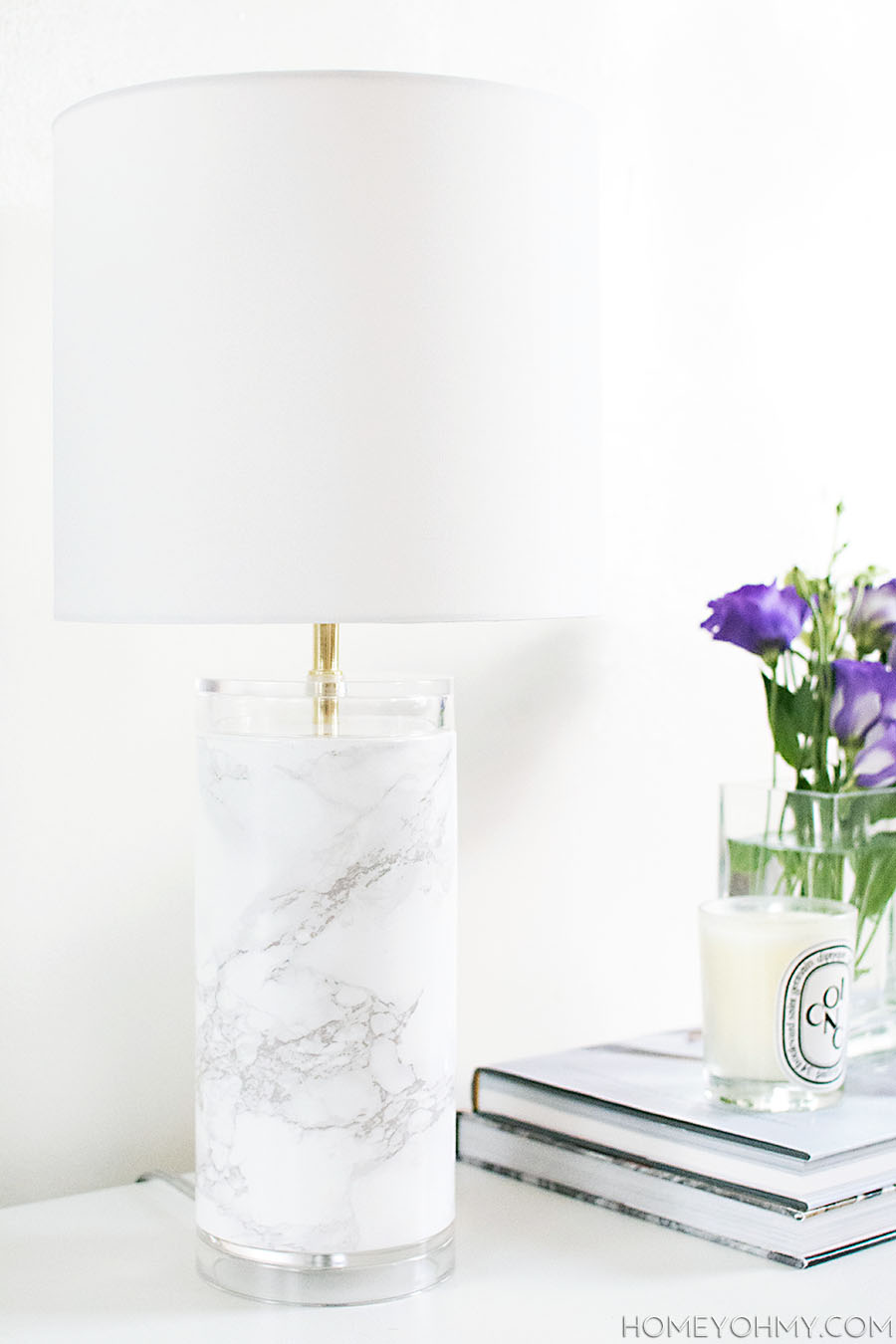 This  DIY Marble Table Lamp is a cheap and efficient way to turn a boring table lamp into something beautiful and exotic. Marble accessories like this look good in any room with a multitude of design styles. Get your craft on with this simple update for a style upgrade!