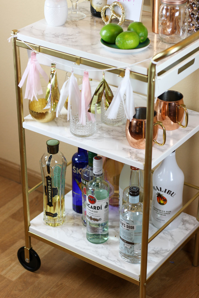 This  Gold and Marble Bar Cart is actually a genius Ikea hack by bloggers Britta and Carli Garsow. It started as a simple Ikea utility cart, and with a little spray paint and marble contact paper, they turned it into this beauty!