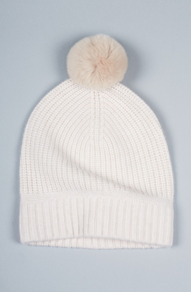 Every fall wardrobe needs a super cute hat to wear with any outfit on those chilly mornings. This super cute  Mardelle Beanie is on the upper end of the price spectrum, but you'll look amazing in such a clean, soft color, and the pom pom on top just totally completes it!