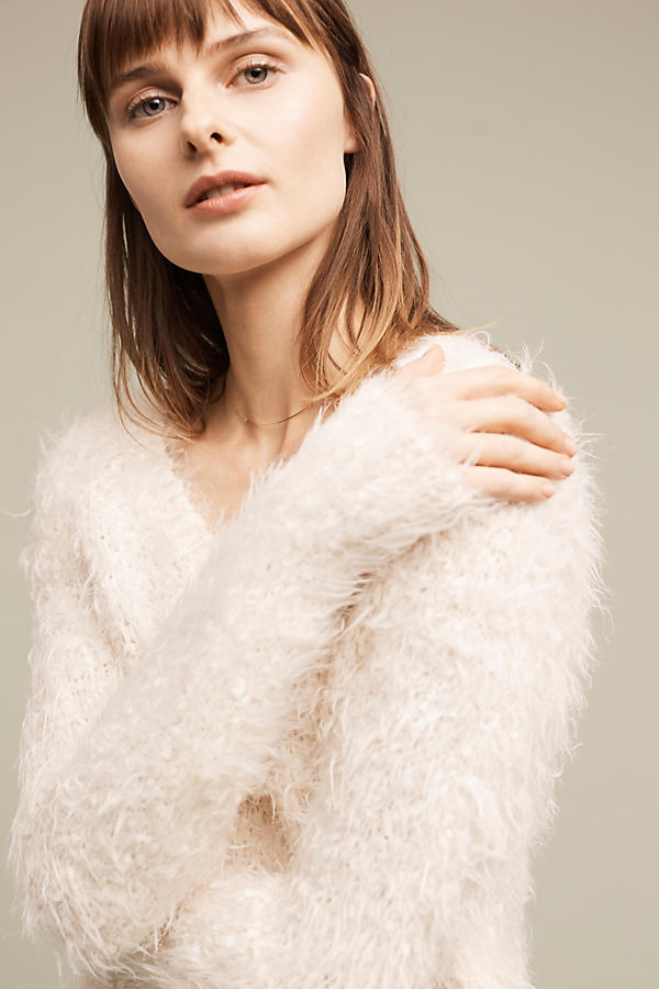 Perhaps my favorite of the list is this  Snowfrost Boucle Pullover from Anthro. I can't imagine who wouldn't want to snuggle up in this all day long! You can pair it with literally anything and it's quite a showstopper for both upscale events and everyday life. The key this season is comfort and coziness, but it never hurts to look good too!