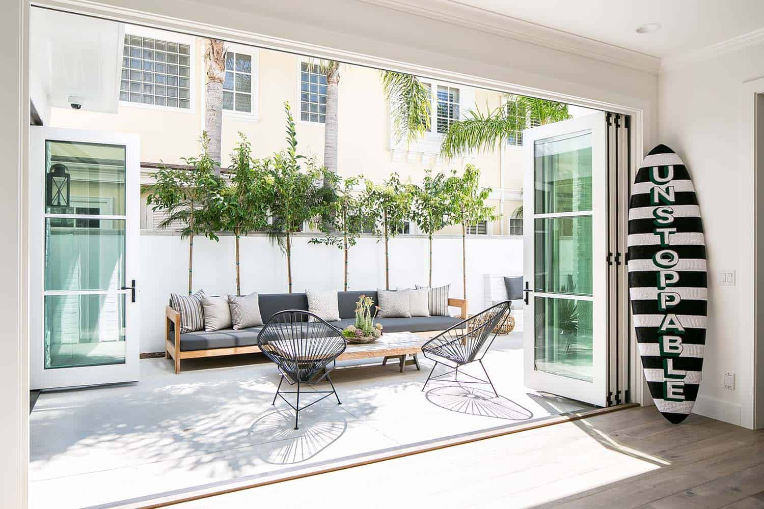 Comfortable sofas and outdoor chairs for a cozy patio space.