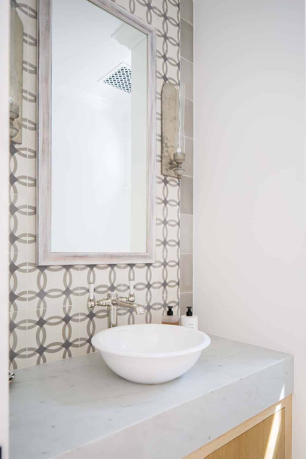 Absolutely IN LOVE with the tile used in the powder room.