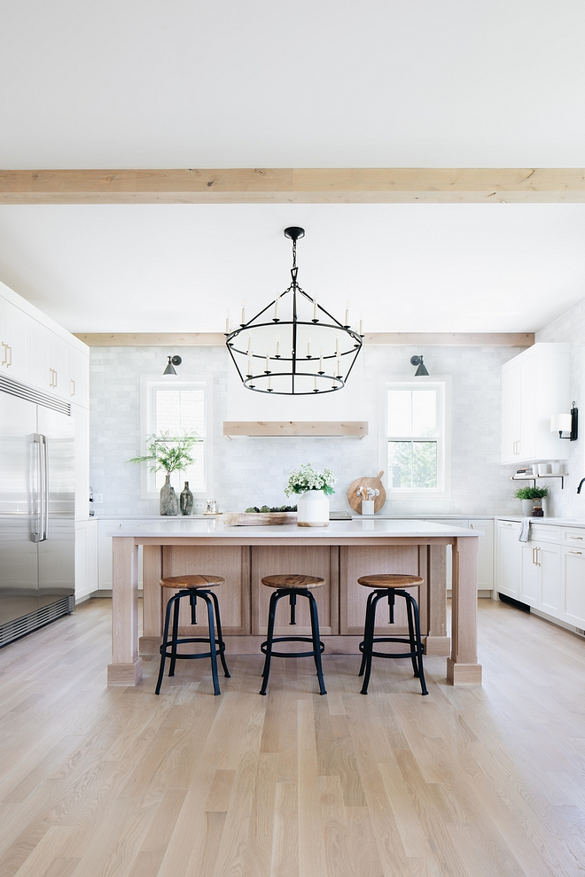 The custom designed kitchen island is  Quarter Sawn White Oak  and it features extra room for stools on both sides of the island.