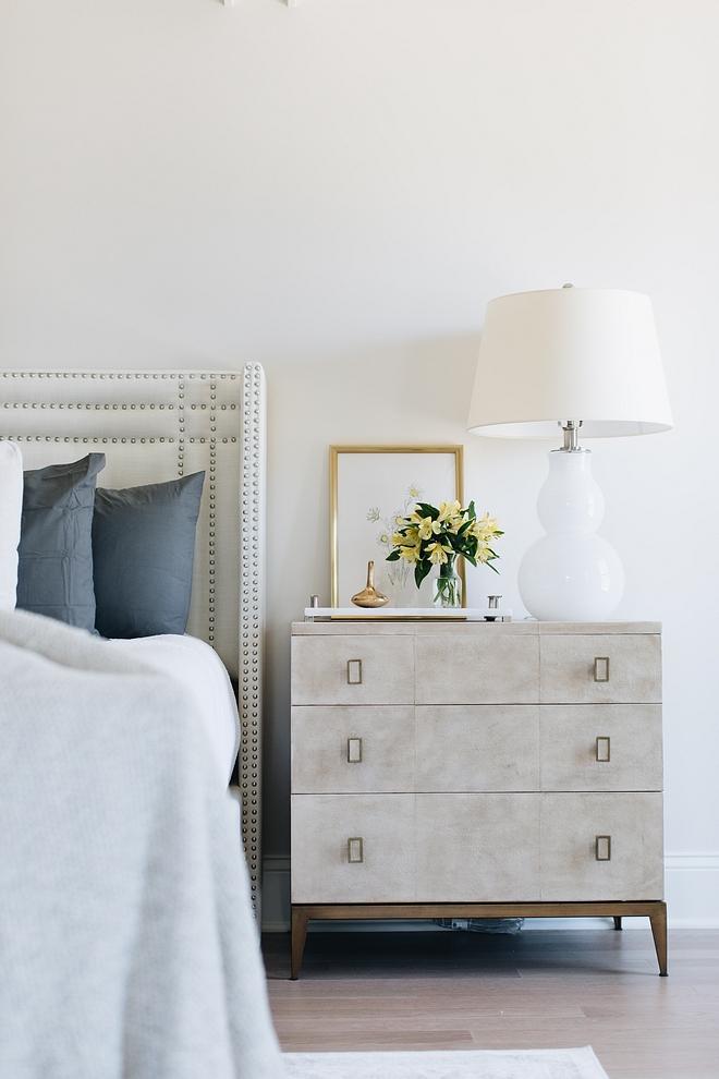 The bedroom wall paint color is  Benjamin Moore Classic Gray.  Nightstands are from Walter e Smith