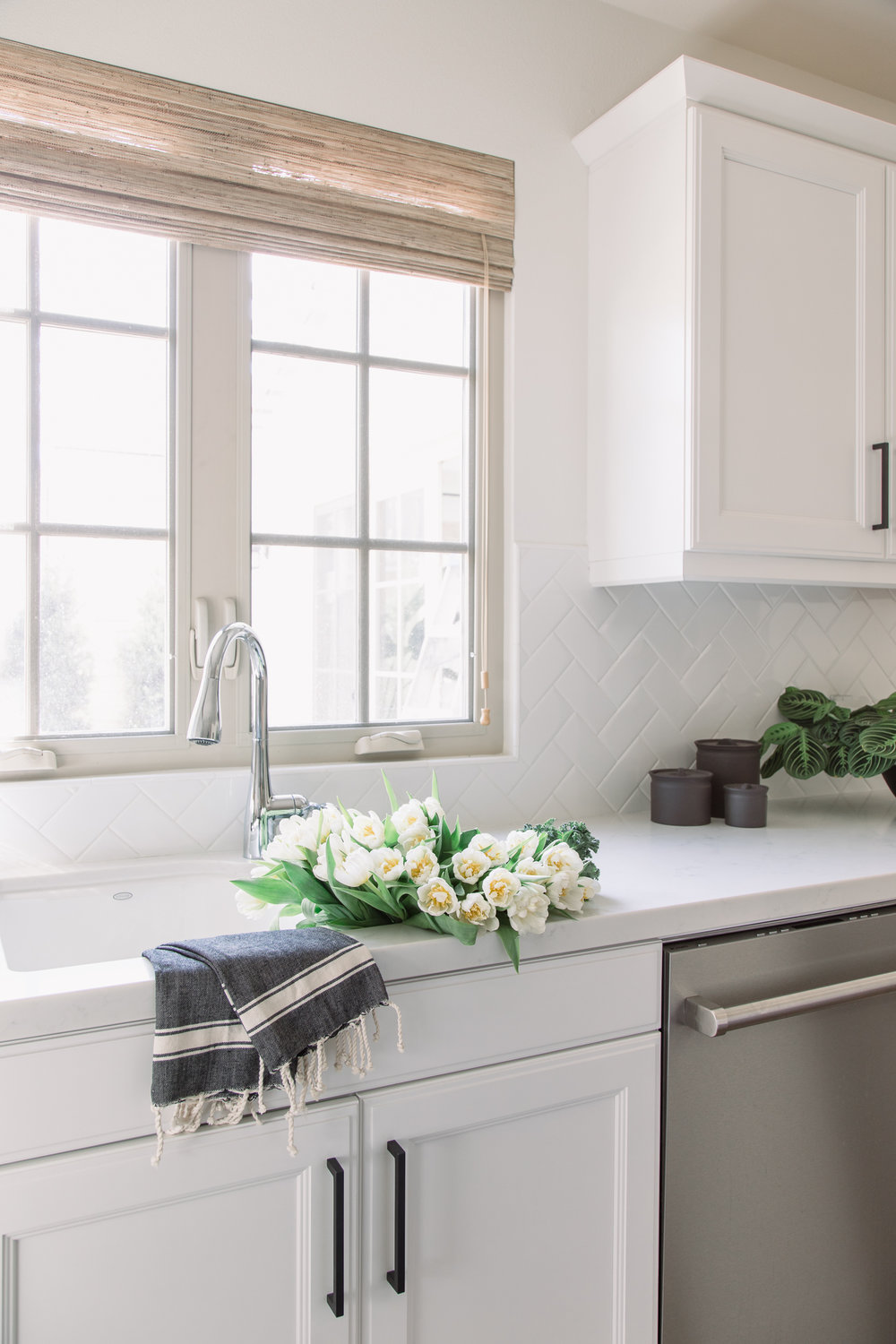 The herringbone subway tile backsplash is almost invisible, but just enough to give it texture that pops out.