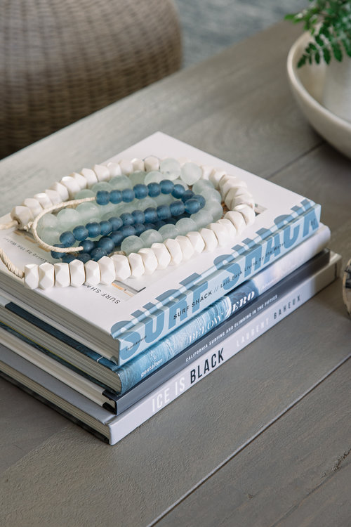 Seaglass beads as decor on the coffee table bring something unique into the design that actually came from the ocean.