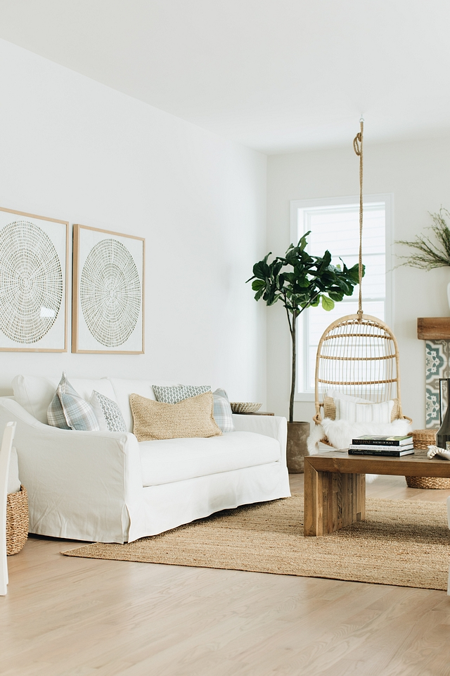 I'm loving the zen artwork on the walls and the minimalist framing that echoes the natural shades of the room. The sofa also has that perfect coastal farmhouse vibe that looks like a white sand beach but also makes you want to cuddle up in front of the fireplace on cold winter nights.