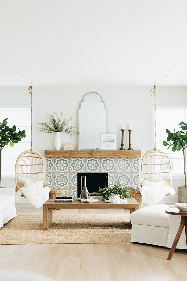 I am OBSESSED with the tiling on the fireplace. It really adds a unique focal point without making the room too busy. The mirror above the fireplace makes for an almost invisible piece of artwork; it's angled upward to reflect the natural  light bouncing off the ceiling. Tile is from The Tile Shop – Cement Encaustic Tile
