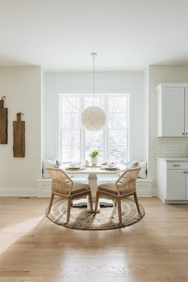 The breakfast nook is just dreamy; it's the perfect spot to sit in the morning sun and drink coffee. The pendant is from Ballard Designs and is simply stunning. It would be perfect in a little girl's room as well.