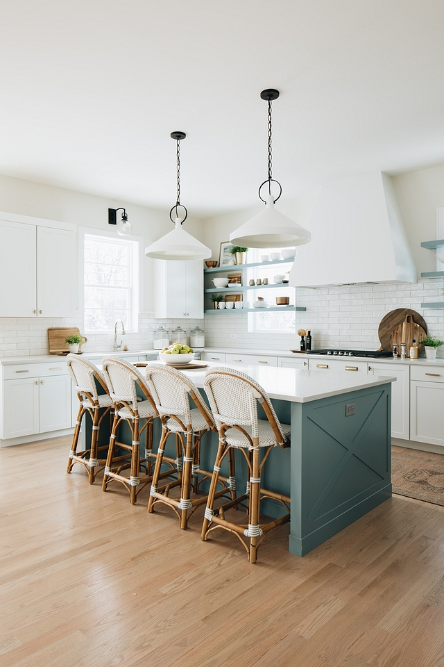 The floating shelves in that soft aqua really add a lovely farmhouse touch to the kitchen. The barstools, from  Serena & Lilly , also bring in elements seen in the rest of the home.