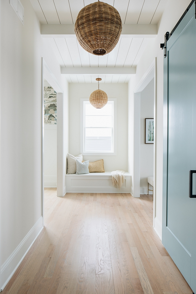 The open hallways are filled with natural light and I love the shiplap and beams on the ceiling. There's really something interesting going on on every surface in the home. The cool pendants are from  Serena and Lilly .