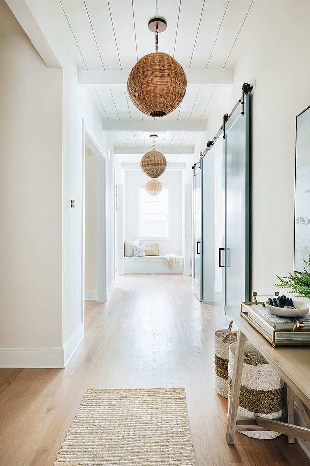 This hallway view shows the huge variety of textures the designer made work seamlessly in the space.