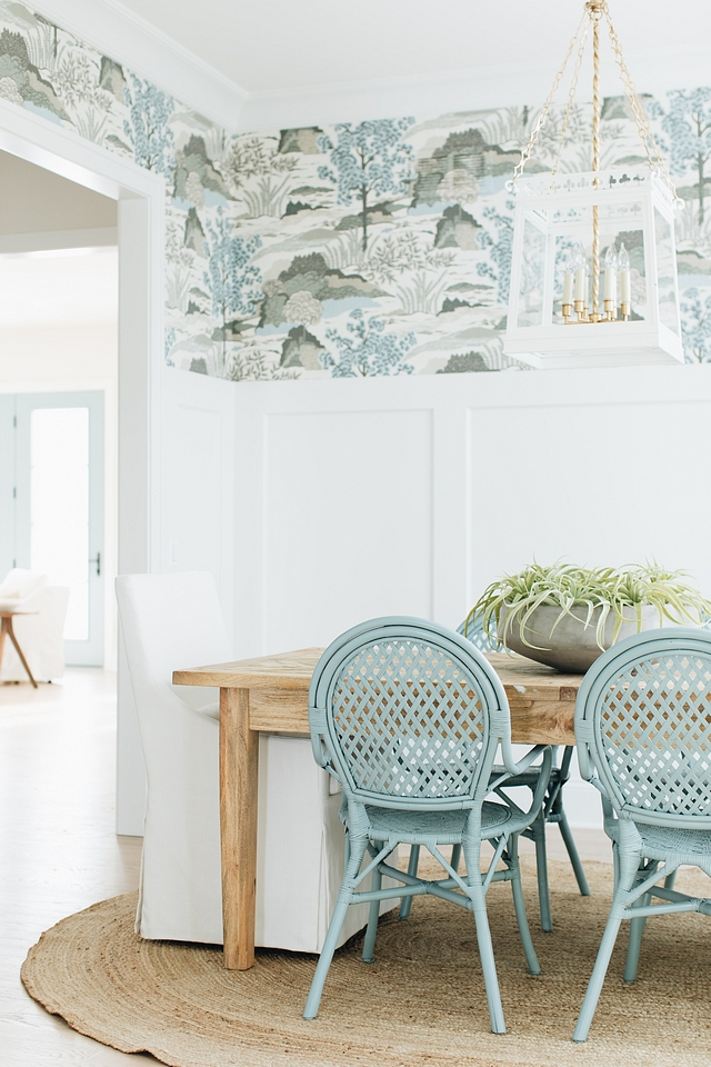 Detail on the dining room pieces: the soft beige upholstered chairs that sit at the heads of the table provide stark contrast with the aqua rattan chairs but they end up working together so nicely for a cohesive yet conversational space.