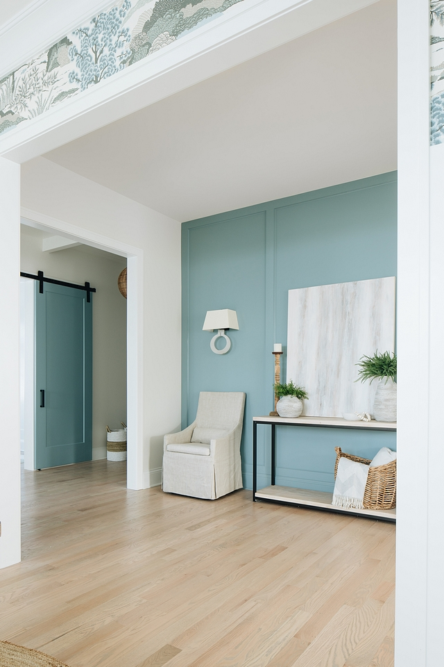 The aqua paneling echoes through the home to coat this entire wall.