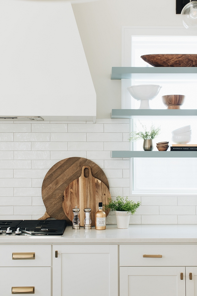Cutting boards like these can provide excellent decor in an all-white kitchen. The contrast of the dark natural wood really stands out.