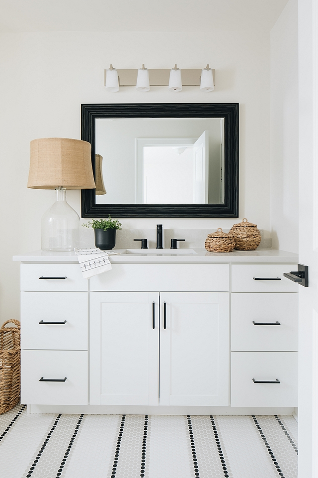 This bathroom goes bold with only black and white, very different from the rest of the home yet powerful.