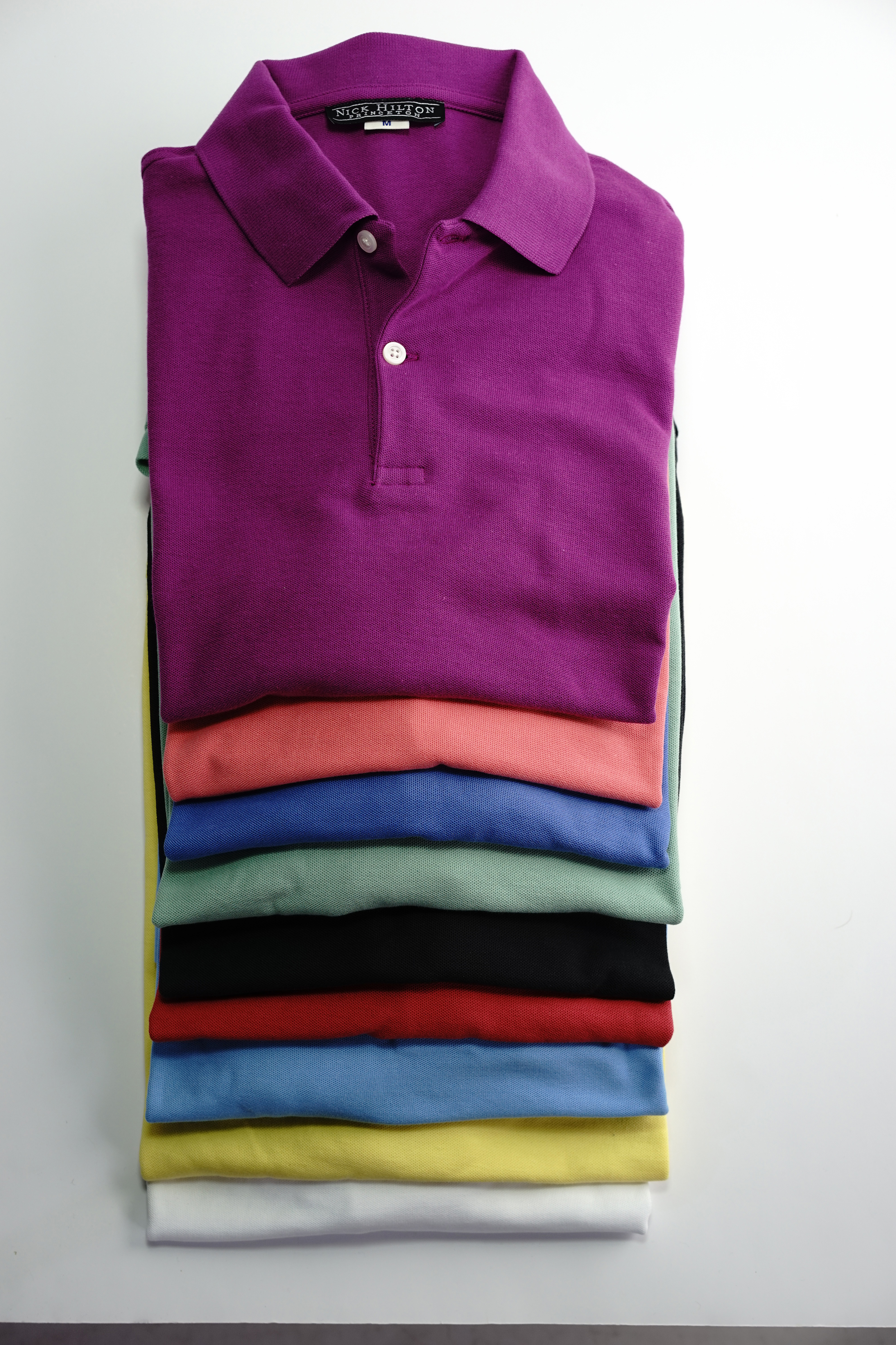 The Nick Hilton polo shirt comes in 9 colors and two fits: trim and classic.