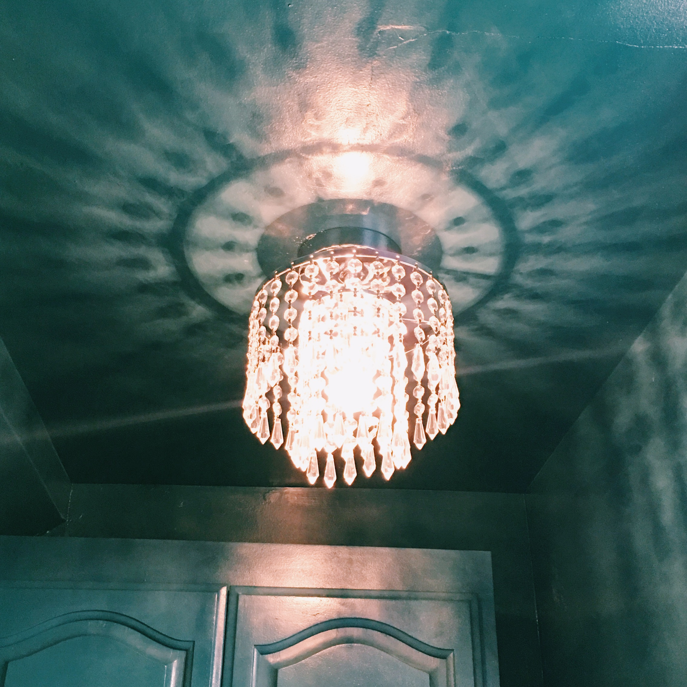 Here's my fancy, bling-y, yet inexpensive chandelier in place. Cute, eh?