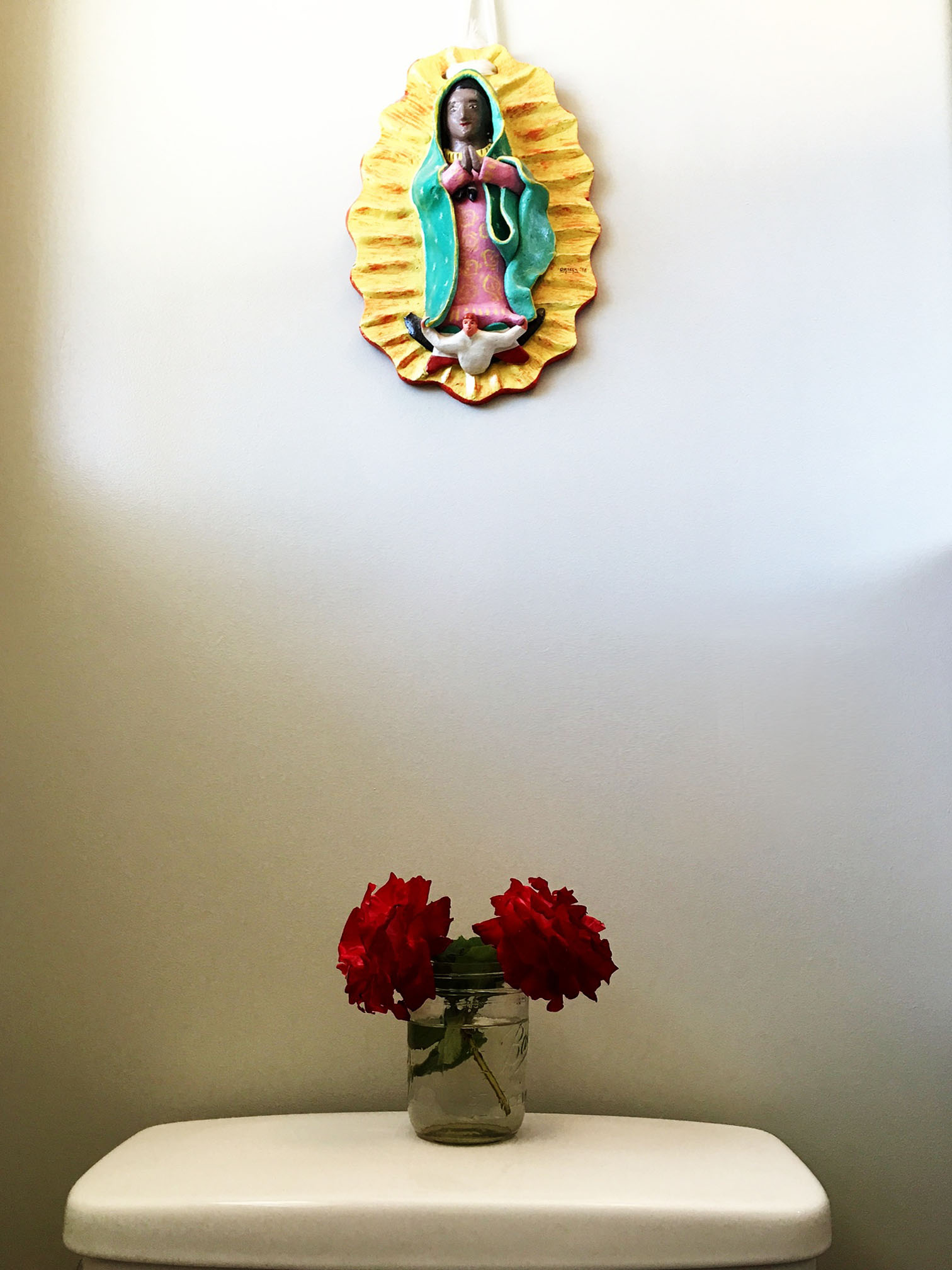 Here's my beloved black Lady of Guadalupe. One of my treasures from when we lived in Mexico.
