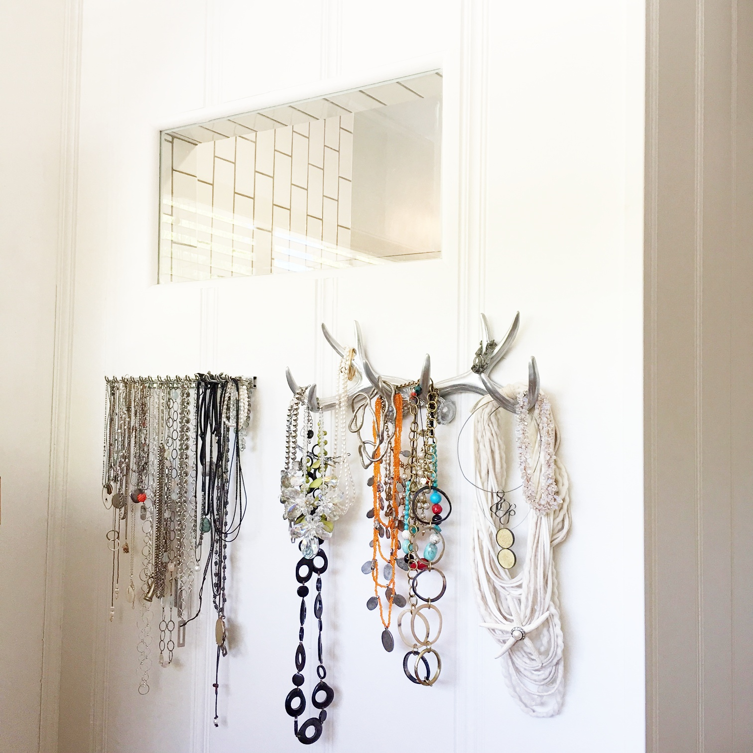 Here is the shower window and a new wall to hang my necklaces (which I have a few of). The one on the left is actually a men's tie holder. The one on the right is a silver painted set of antlers. How cute is that? I got it from my bestie for my bday.