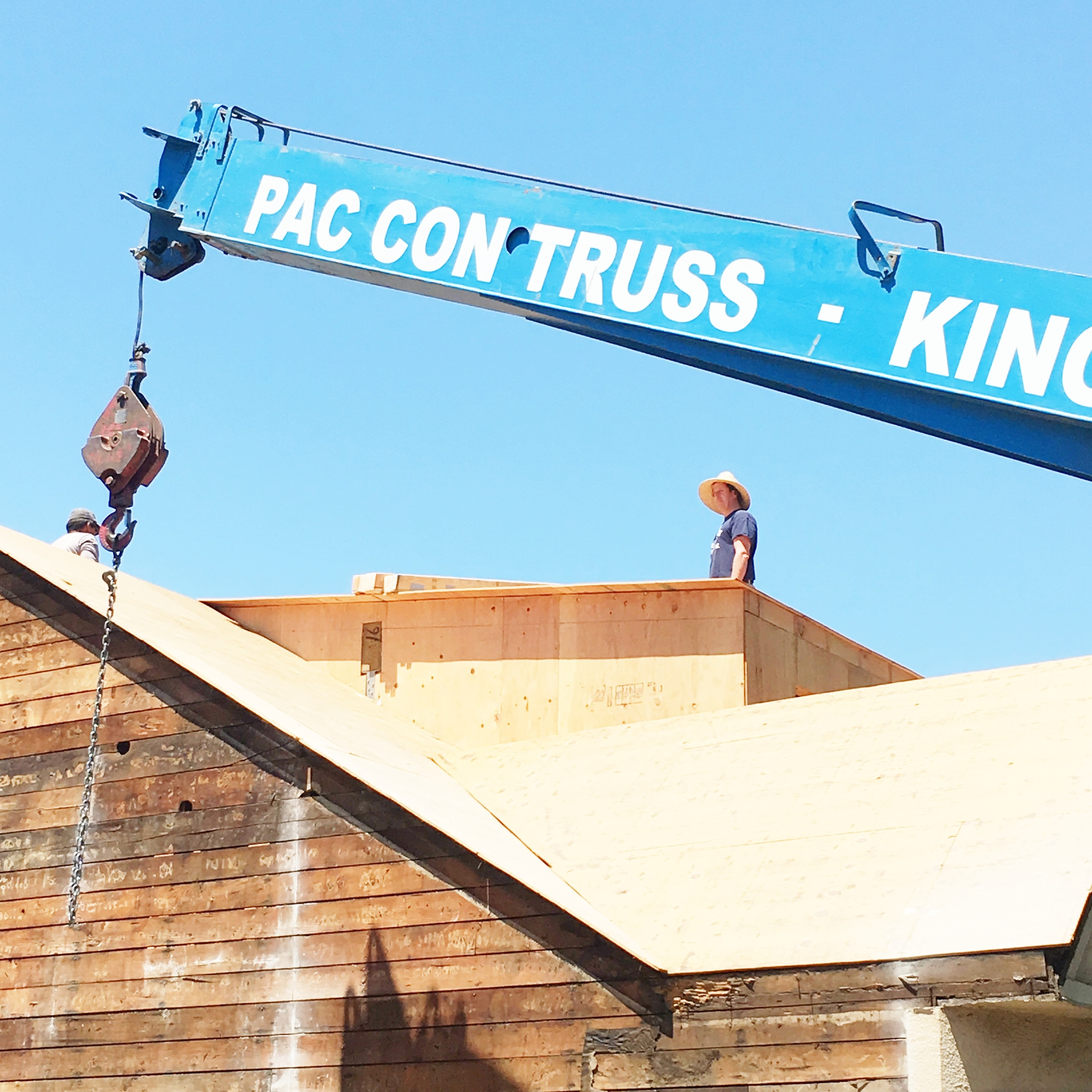 Just a cool shot of Lance on the roof waiting for the crane to start doing its stuff.