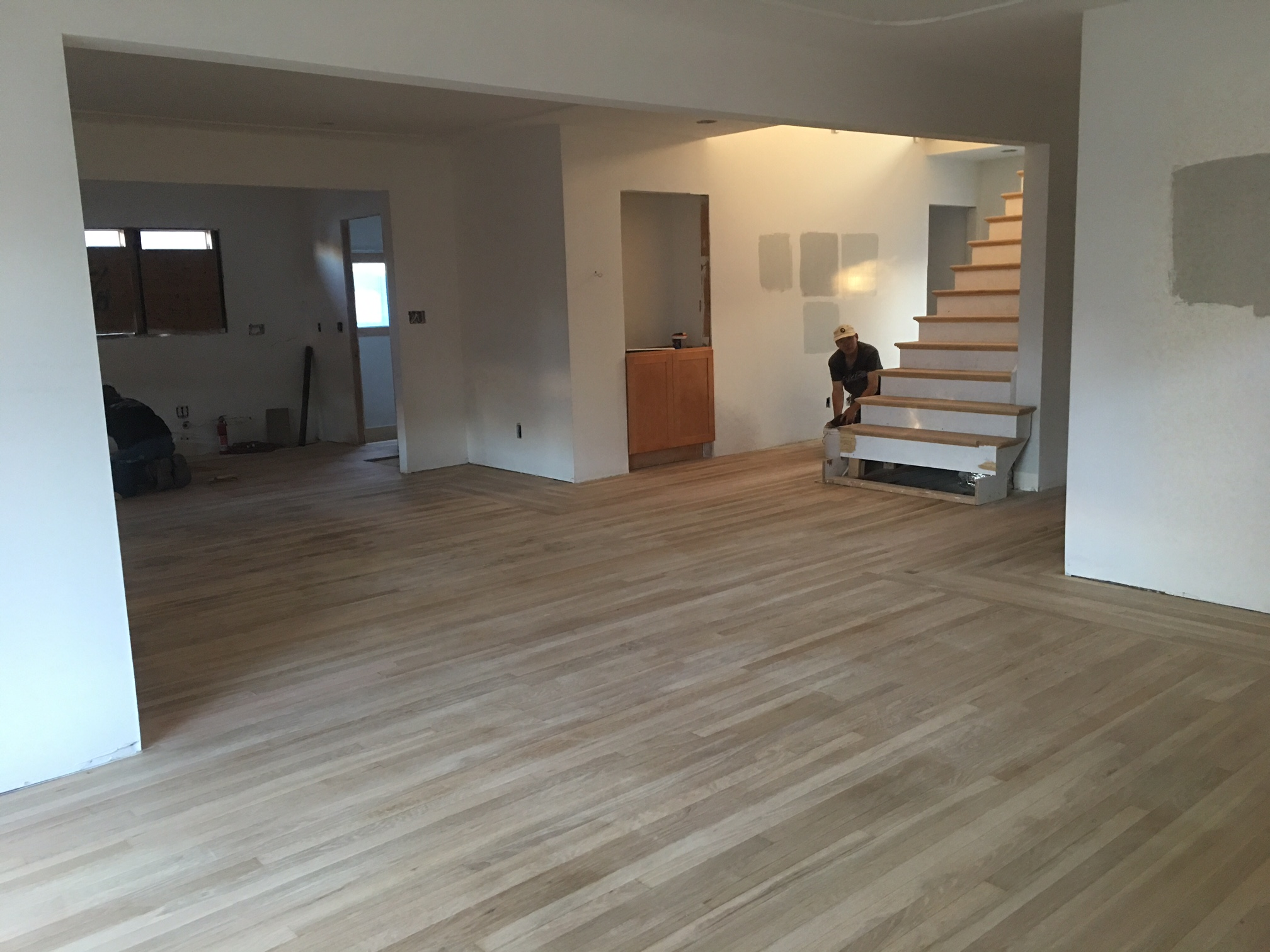 Here's a shot of the newly sanded floors. Remember that what you are looking at used to be 4 rooms so there was a lot of patch and repair that had to happen with these floors. These guys are such masters at what they do!