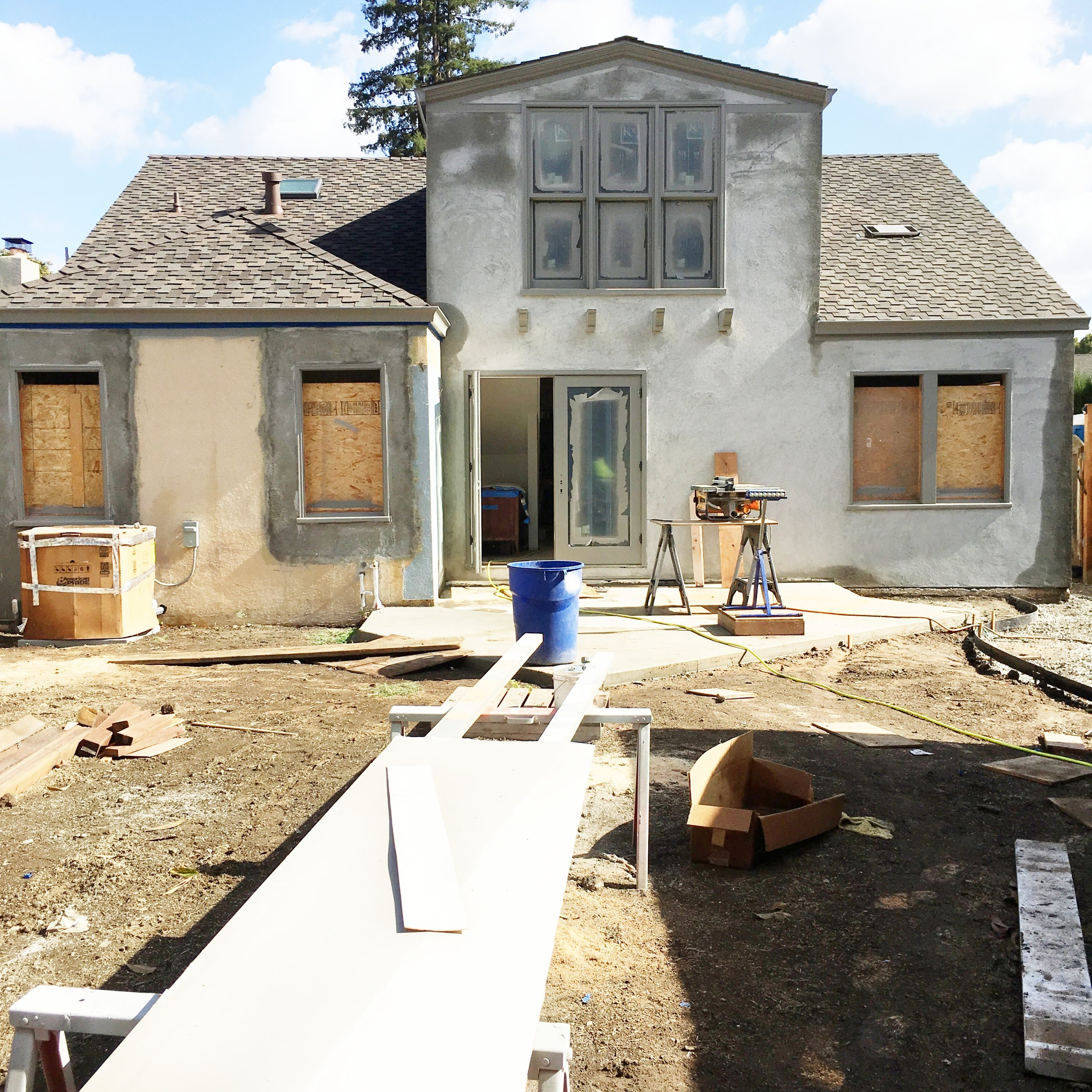 It still looks like a bit of a meth shack but it's coming along. You can see that the exterior trim has all been painted Chelsea Gray (love that color). The base of the back patio has been poured and final stucco will go on later this week. We are mixing the house paint color into the stucco so we don't have to paint. Fingers crossed.