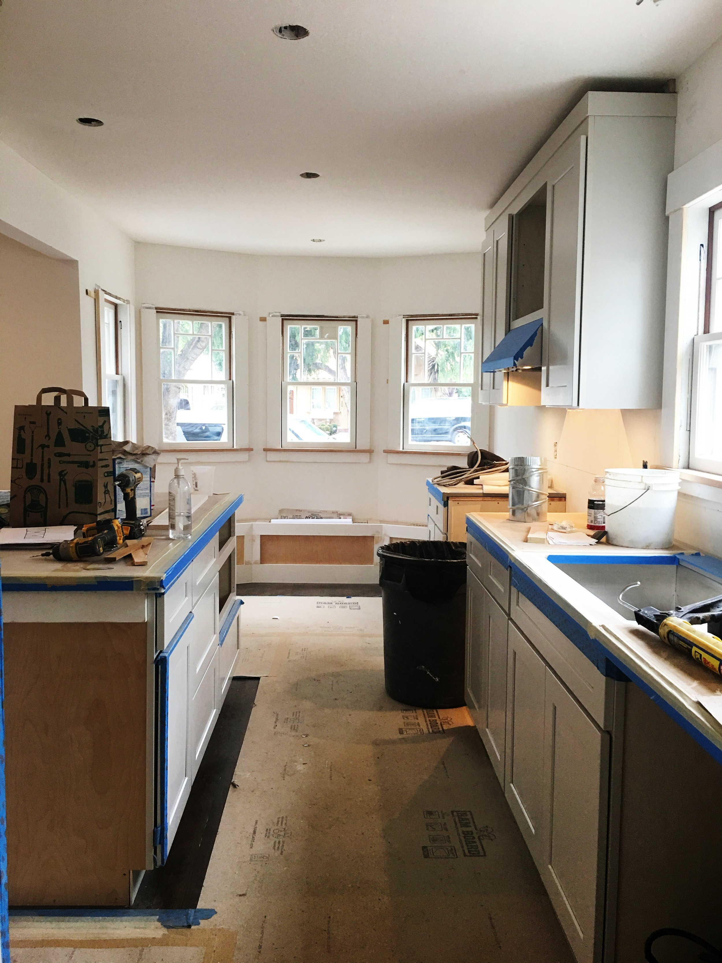 You can't imagine the light that poured into this room when all the plywood finally came down. It's a little bit of a tease because under this cardboard is honed marble, gray granite and beautiful refinished, stained hardwood floors (Douglas Fir in here).