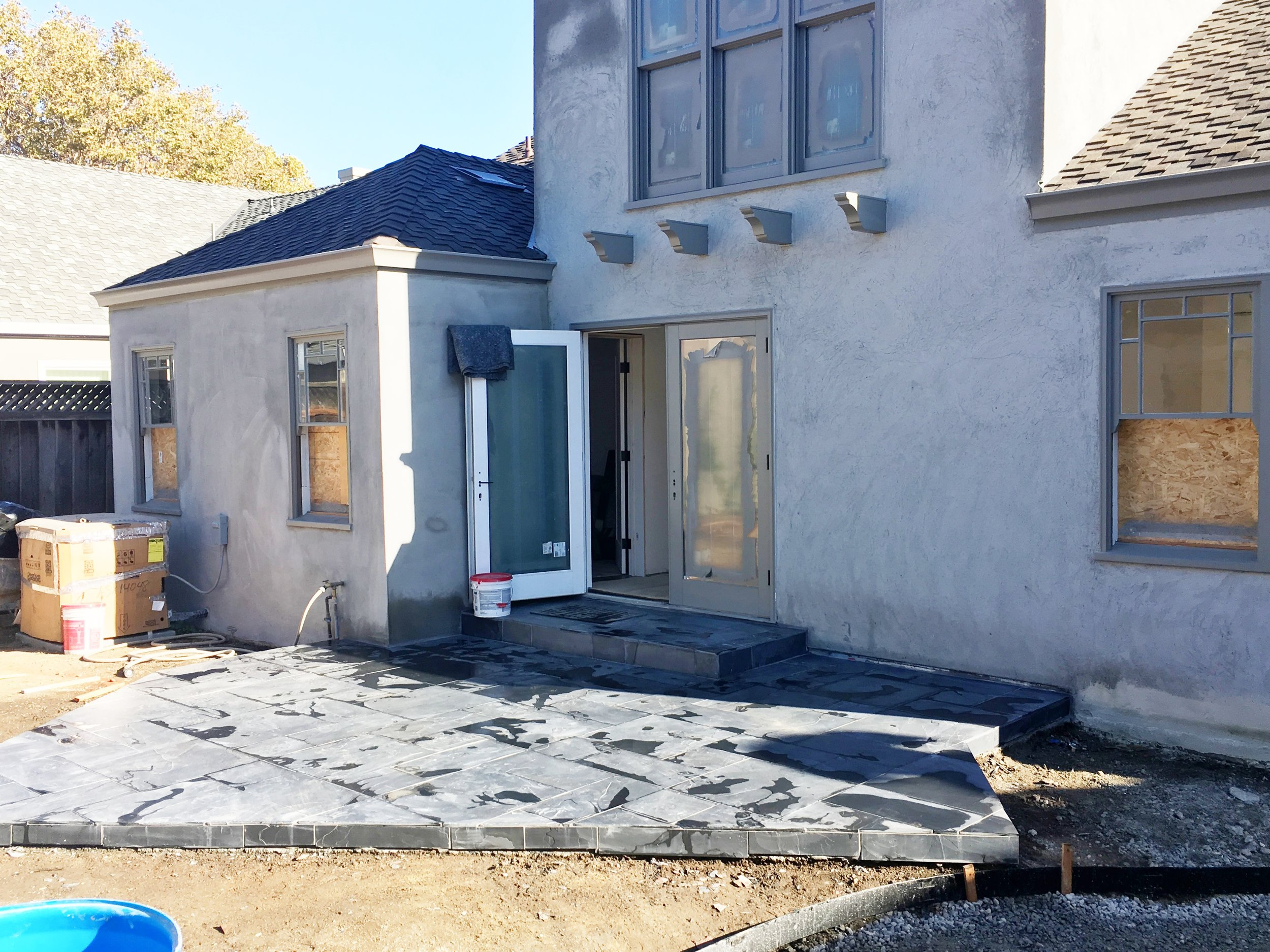 Completely by accident, we landed on this (super reasonable) charcoal gray slate for the patios in a Versailles pattern. Its dirty but you get the gist.