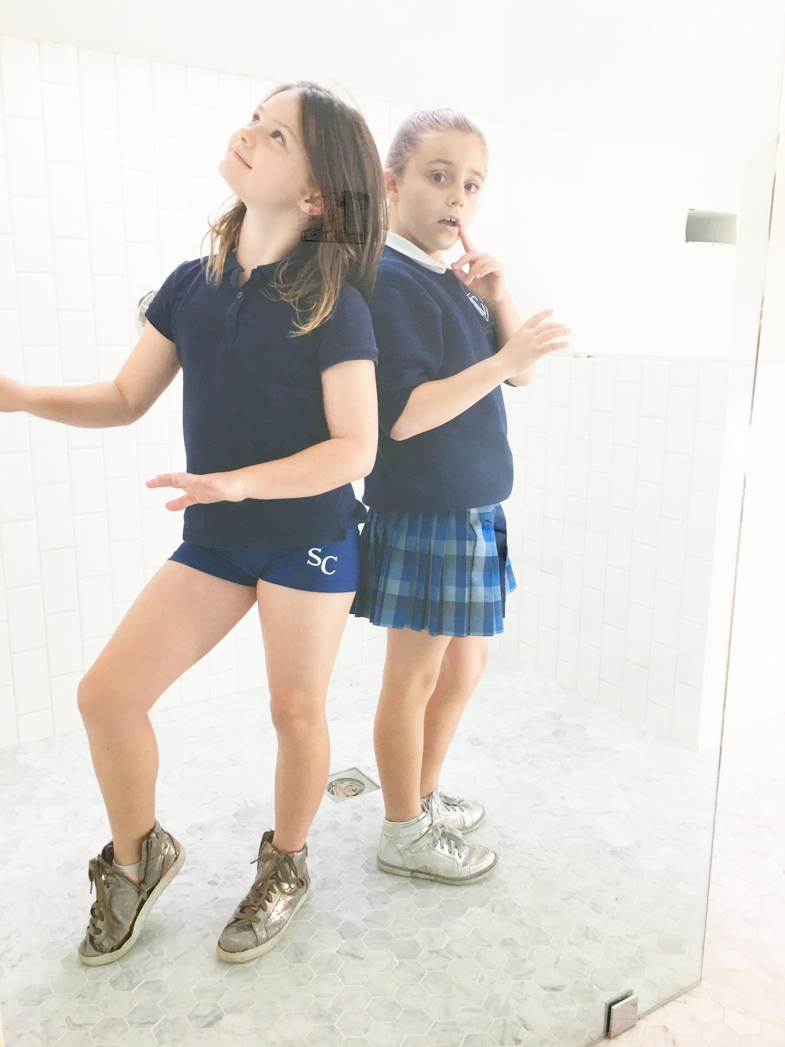 This is Lucy and her friend, Capri, voguing in the master bathroom. By the way, for anyone who remembers (and was worried for me), we fixed the carrera floor issue. Huge headache. Huge relief.