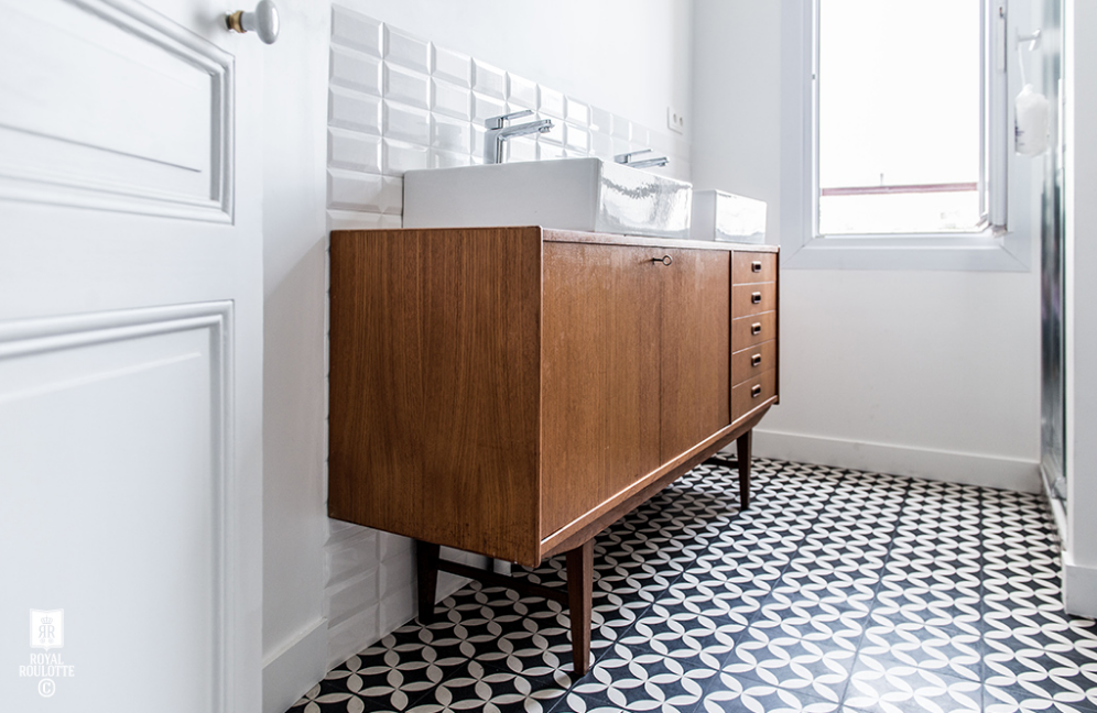 If you recall, we purchase two 1920's vanities for each of the bathrooms in the main house. The guest bath is getting an above-the-counter sink (like you see above). The master is getting a trough sink. Below, you see David cutting into the top of the vanity (eeeek, it hurts me) in order to retrofit the sink and the plumbing (not an easy task).