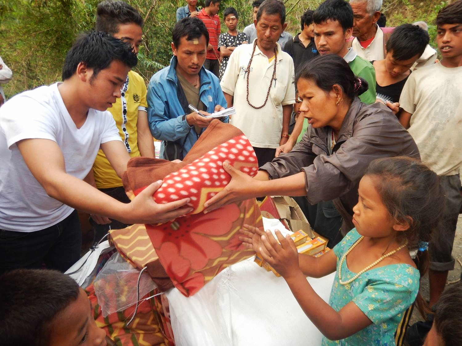 Handing out blankets and supplies to people of the Bolde Phepiche Timal Village