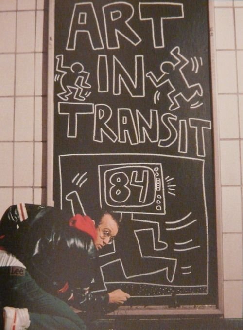 Keith Haring finishing a subway drawing, 1984