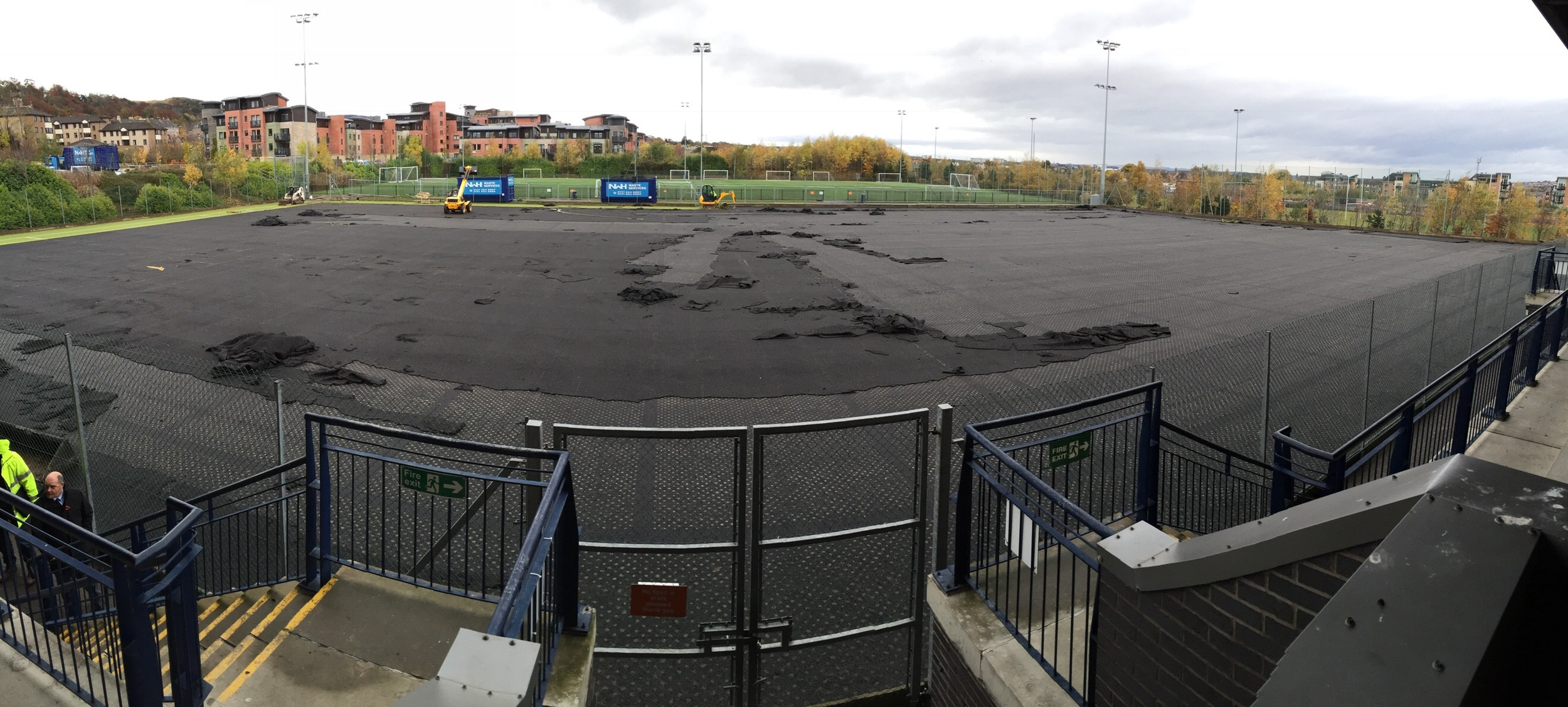 View from stand looking west, here the old shock pad is being removed prior to localised repairs being made on the macadam substrate.