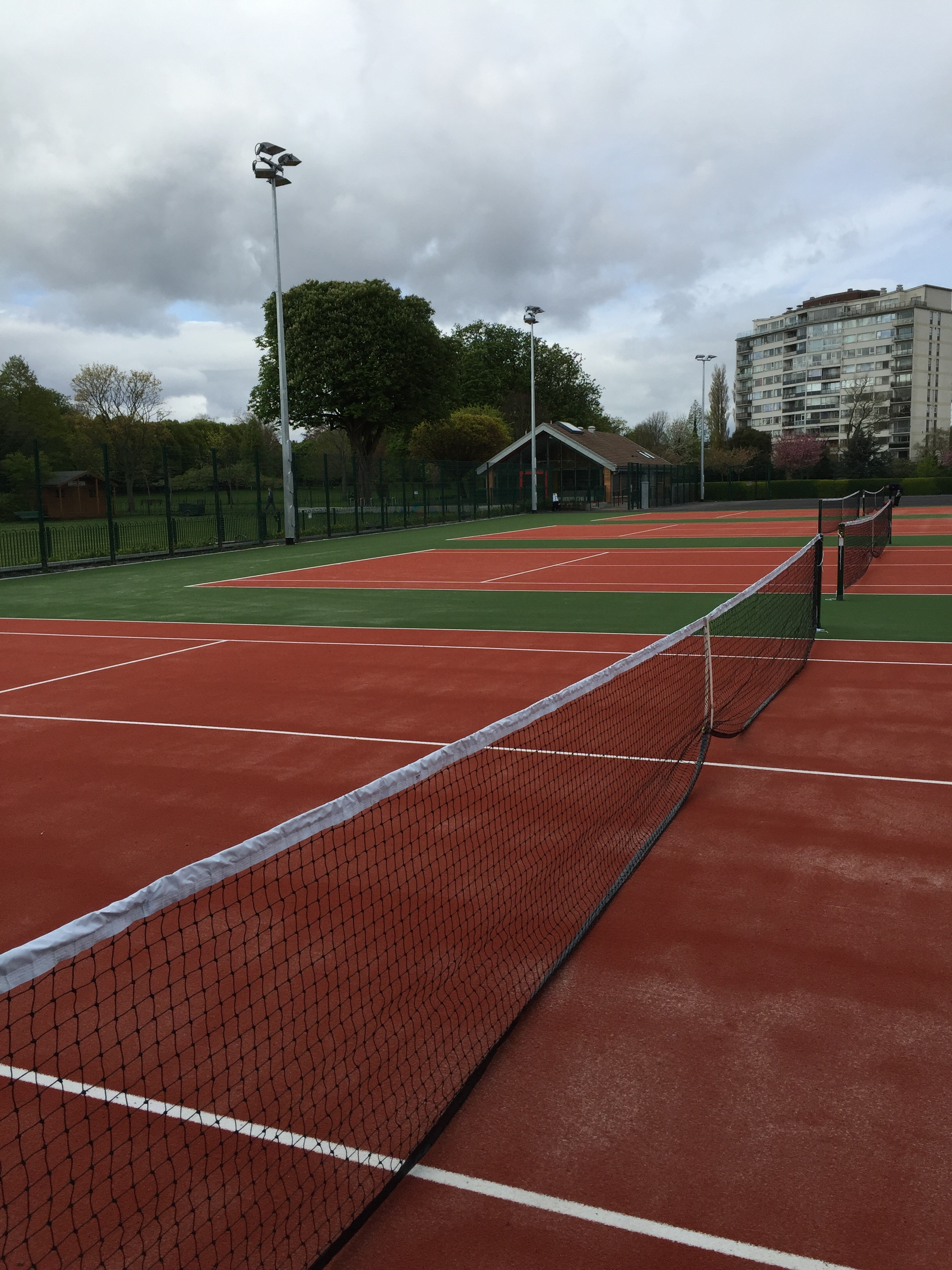 4 new sand filled artificial turf courts and 2 No. acrylic courts catering for both development surfaces and elite tennis players