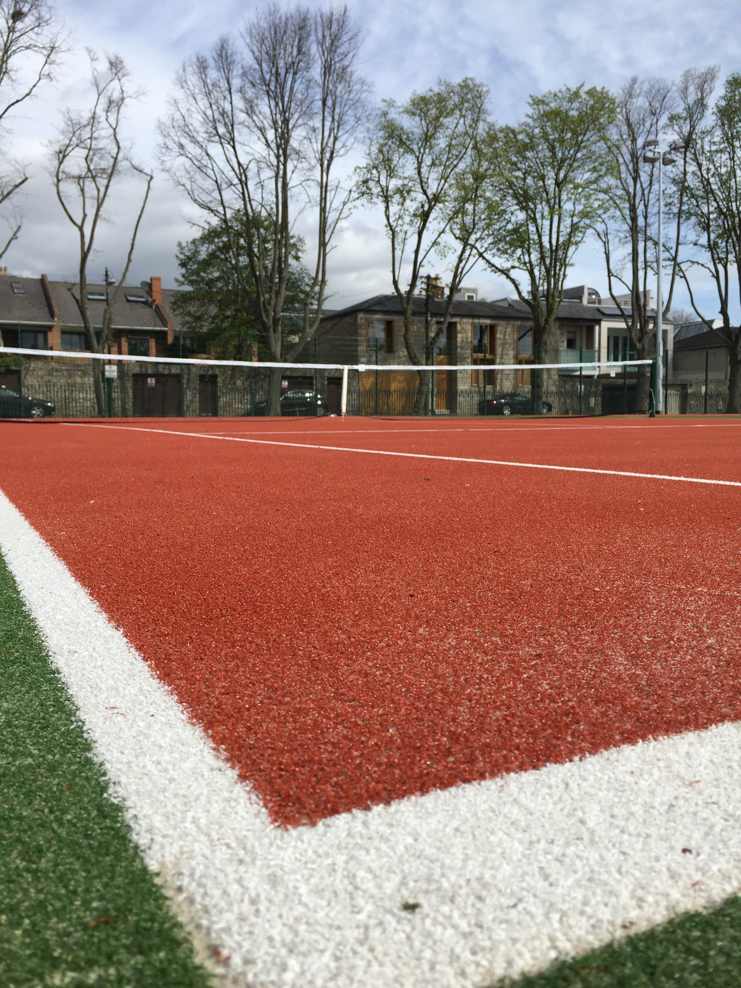 Sand filled turf provides an all weather playing surface for tennis