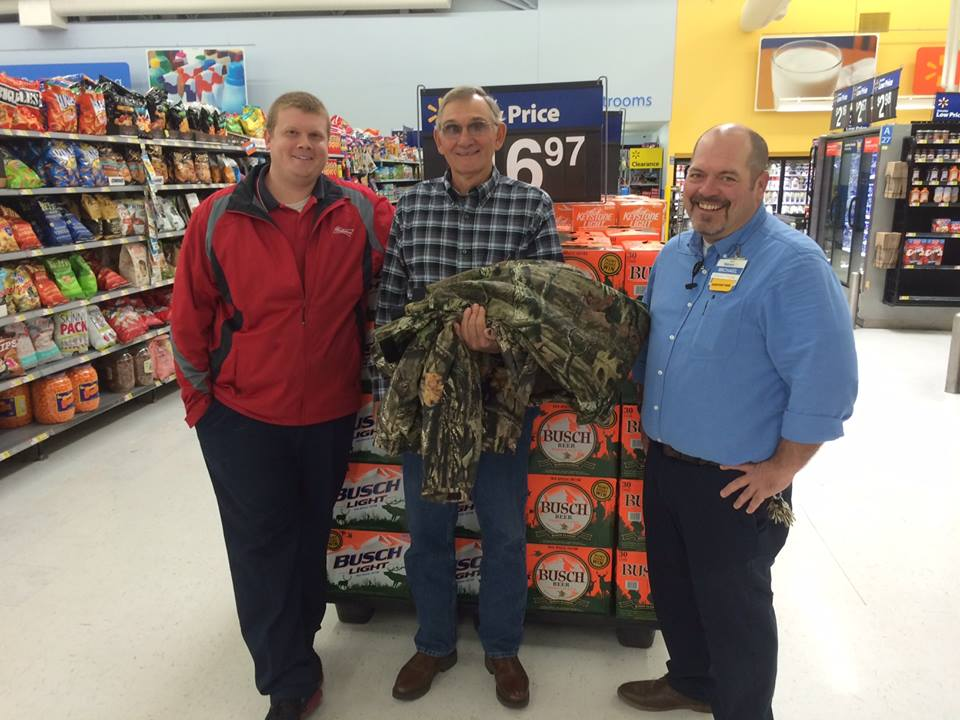 Left to right: Justin Rines from Luecke Distributing, Rowland Thompson, and Michael Richardson of Wal-Mart.