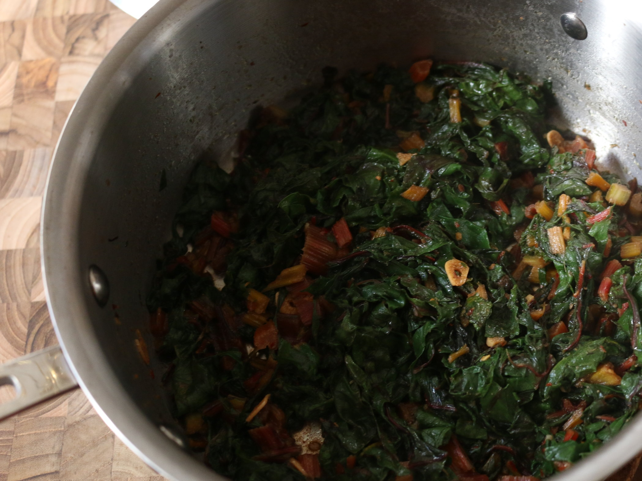 mix - in leaves and continue cooking until cooked through