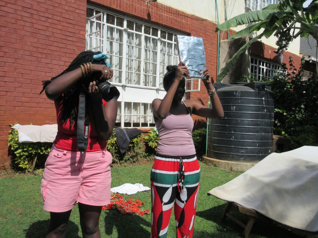 Awuor on camera and Deb working the make-shift reflector :P