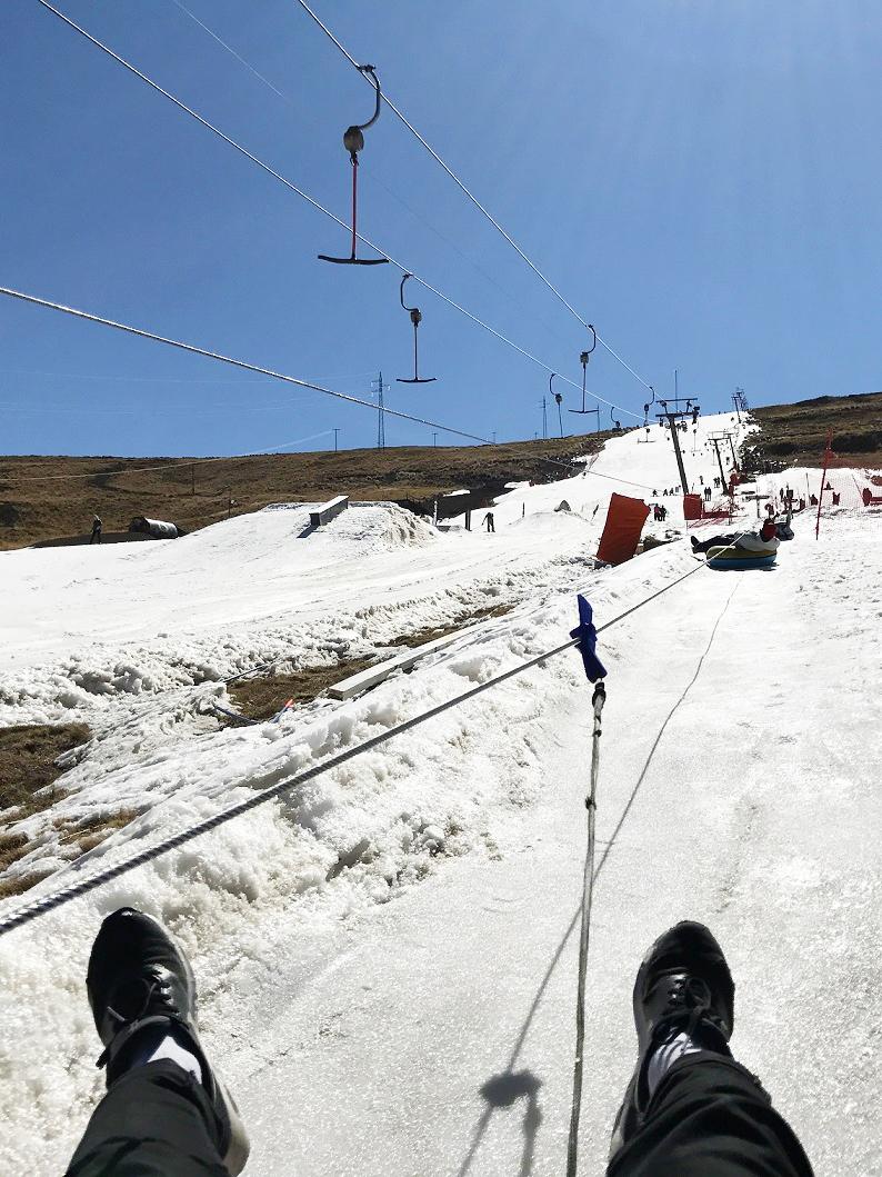 feet_ski_lift_tbar_snowy_slopes