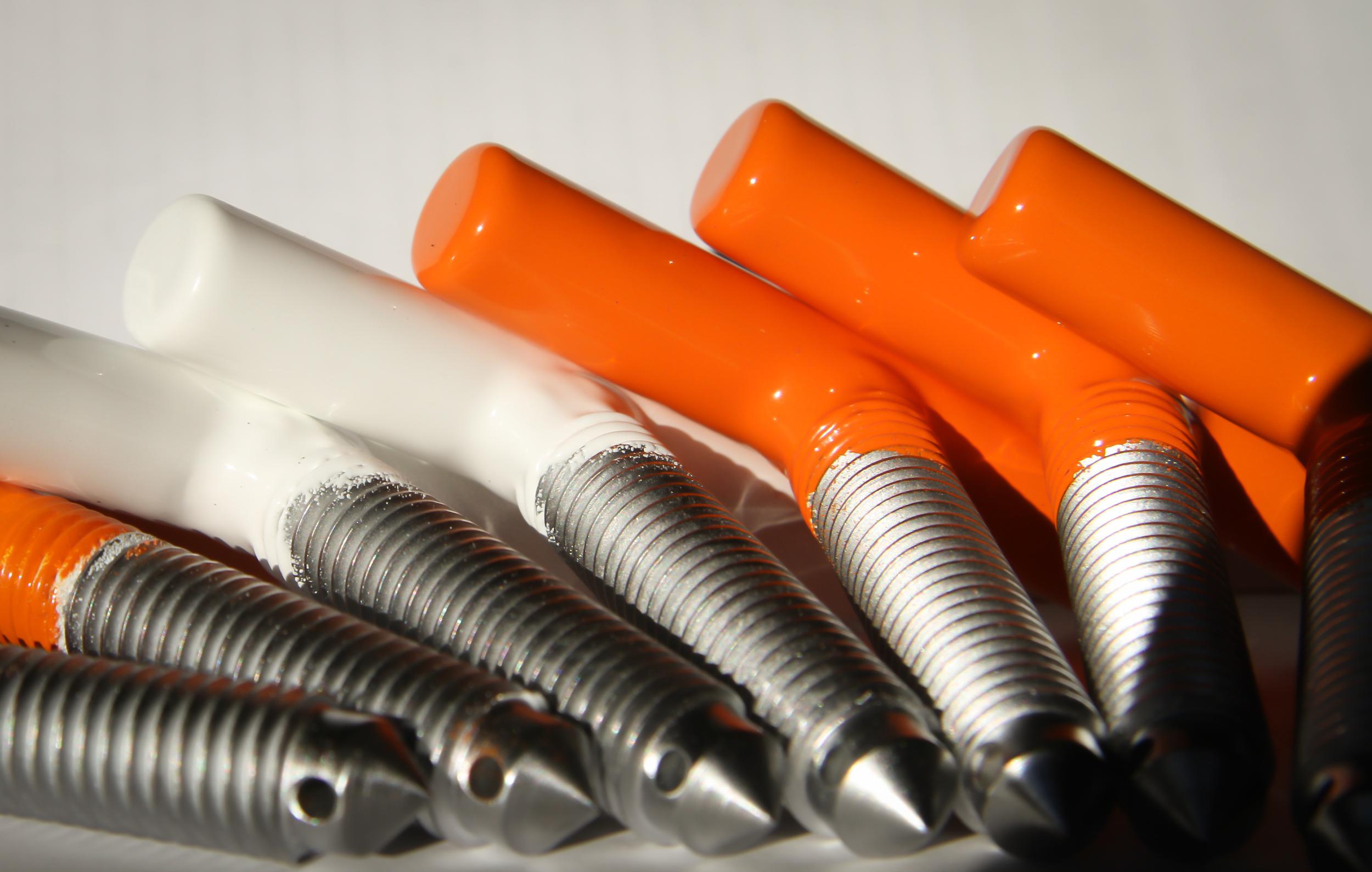 White nylon base. Orange polyester top.