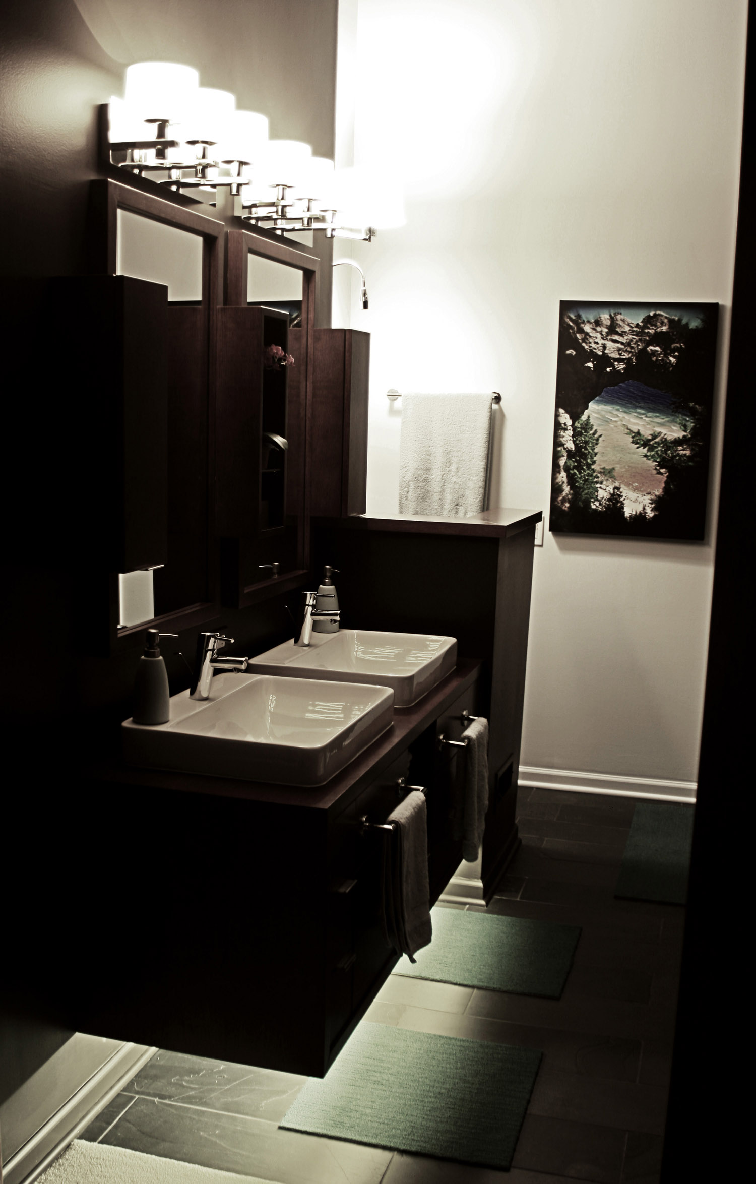 6 masterbath entry view of wall mount vanity night.jpg