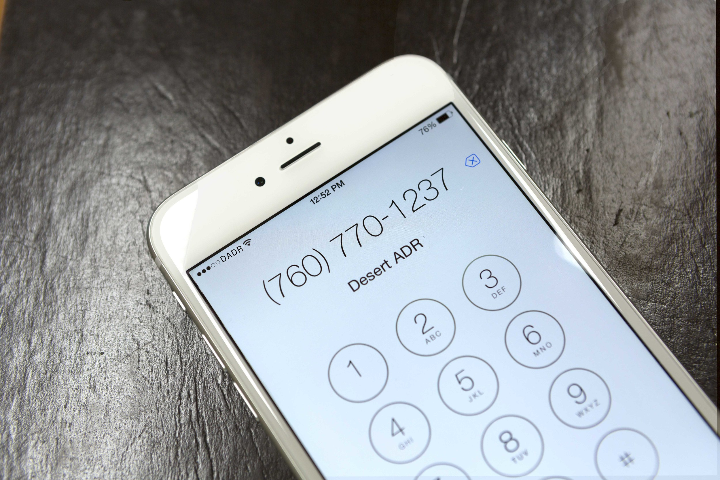 Image of cell phone showing phone number for desert ADR: 760-770-1237. photo by judge robert taylo (Ret.)